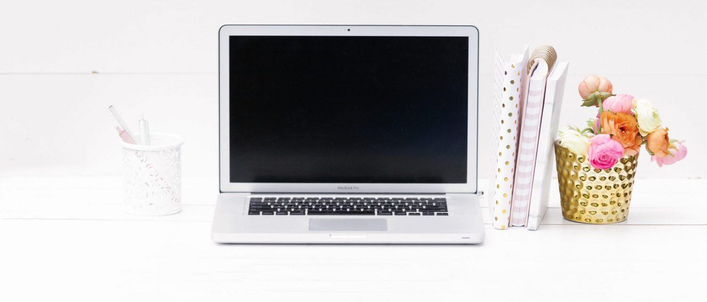 blank laptop screen sitting on desk