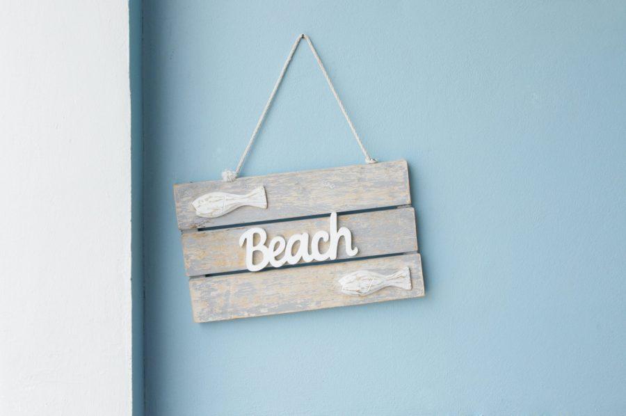 Beach slogan on wooden sign