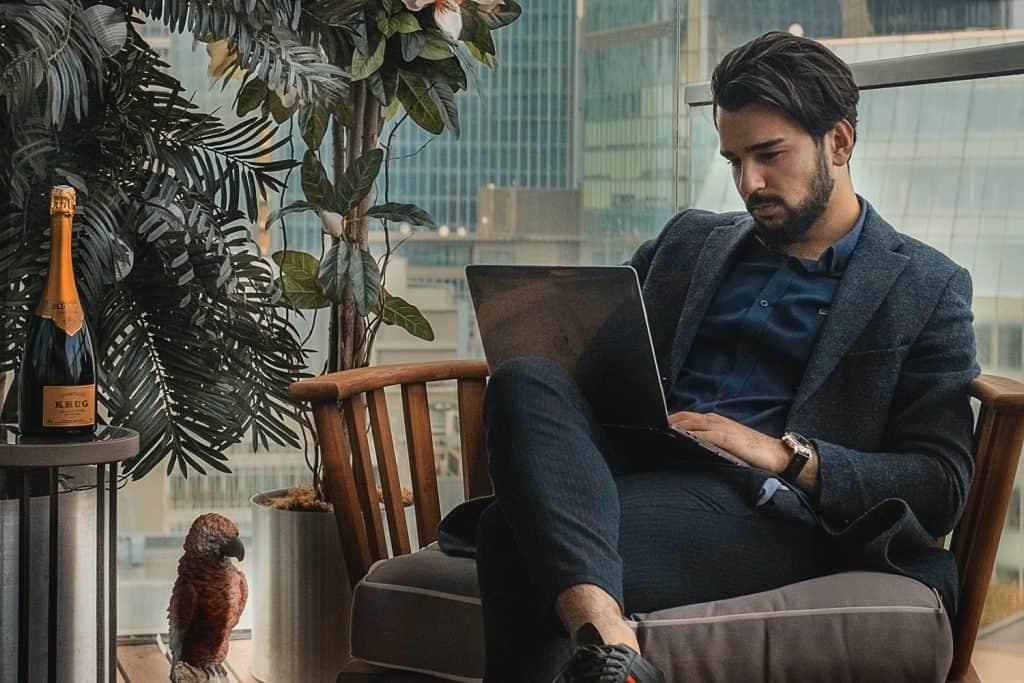 rich man working on laptop