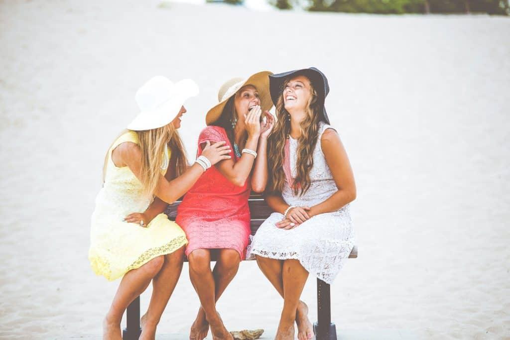 girls telling each other a secret