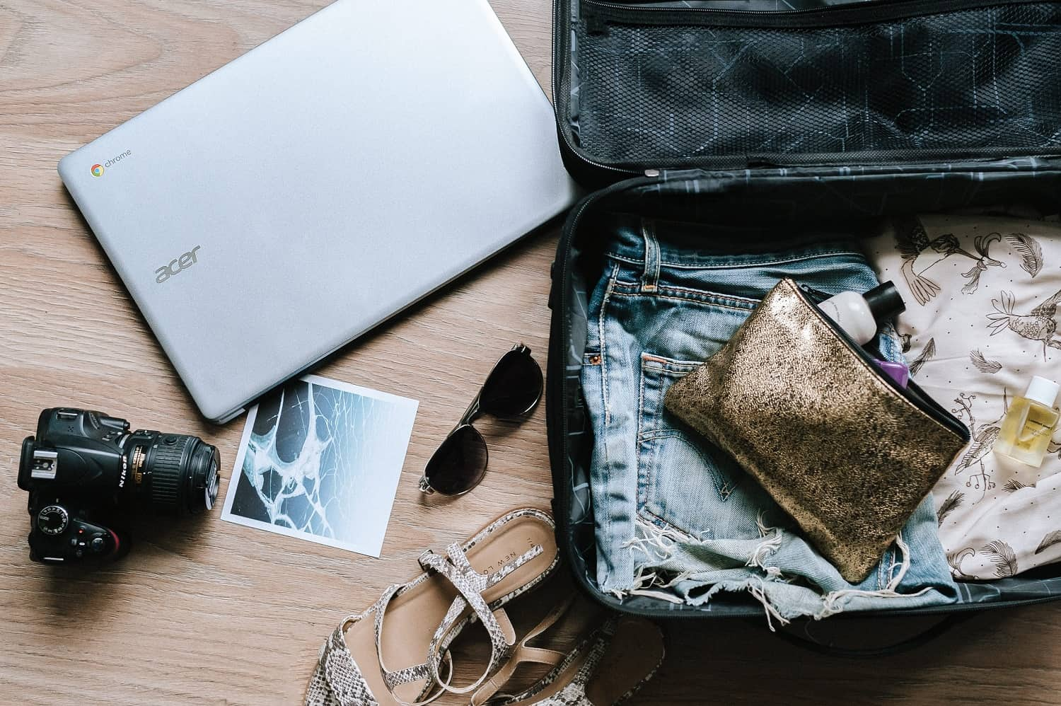travel blogger suitcase and laptop